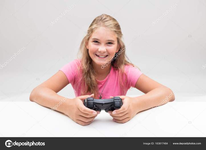 blonde girl in pink is a videogame player