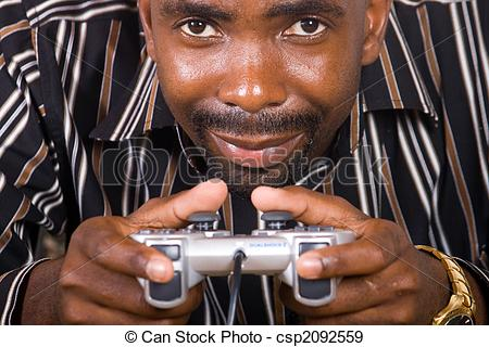 man-concentrating-on-video-game-stock-photograph_csp2092559