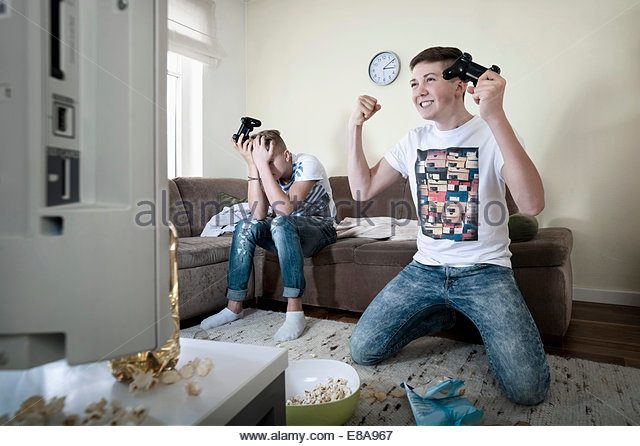 two-teenage-boys-playing-video-game-e8a967